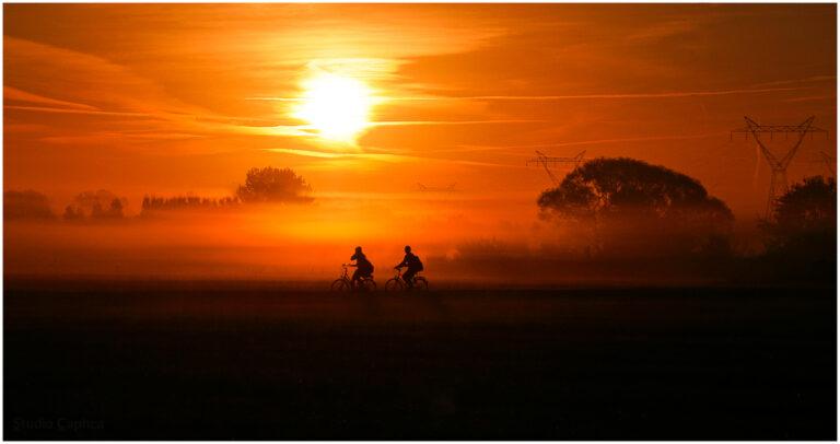 fietsers_bij_zonsopgang_Mortsel_Silhouette_Sunset